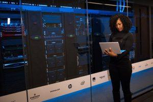 Technician checking web hosting servers